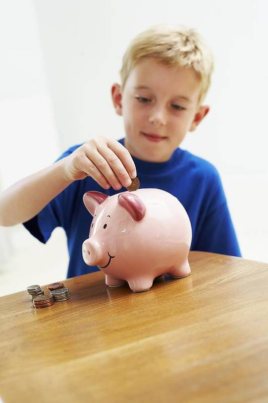Money Box Art Print featuring the photograph Child With A Piggy Bank by Ian Boddy