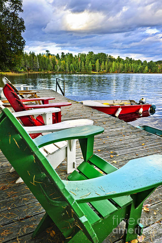 Adirondack Chairs Art Print featuring the photograph Deck Chairs On Dock At Lake by Elena Elisseeva