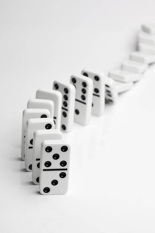 Vertical Art Print featuring the photograph Dominoes Falling Over In A Chain Reaction by Larry Washburn
