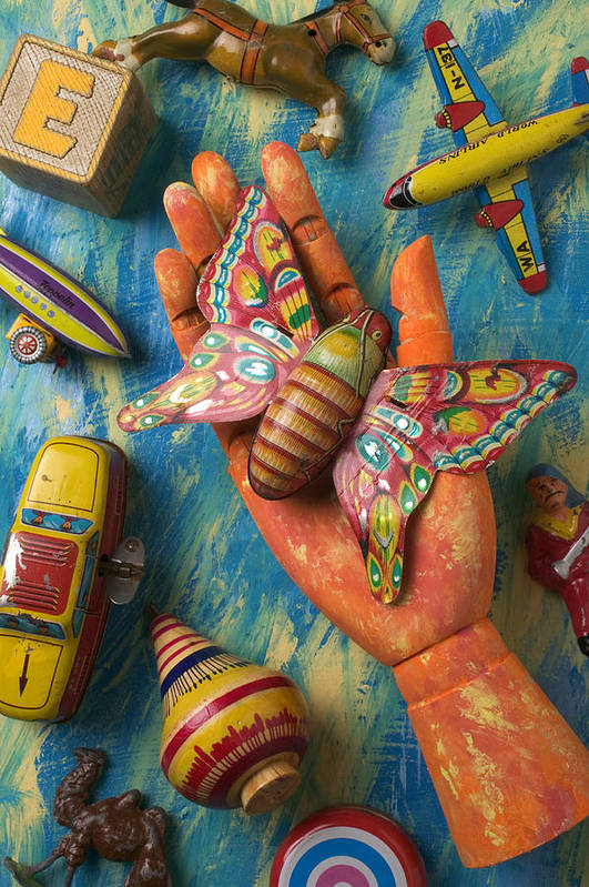 Wood Art Print featuring the photograph Hand Holding Butterfly Toy by Garry Gay