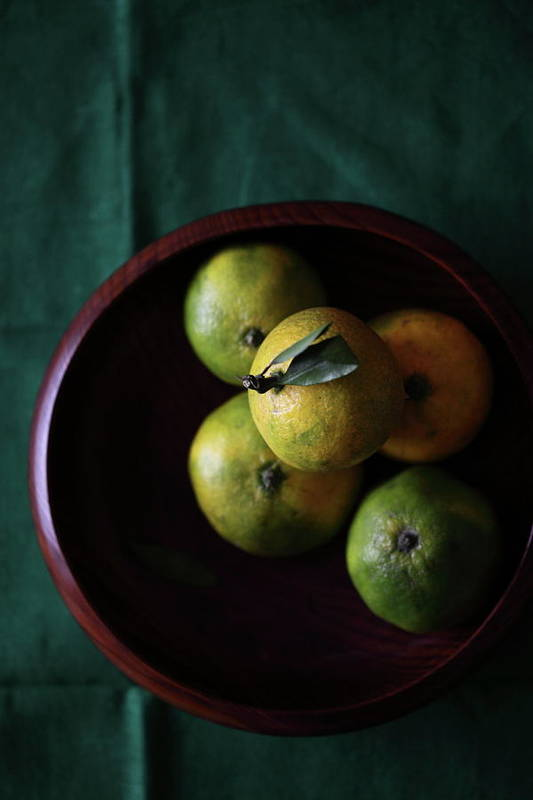 Vertical Art Print featuring the photograph Mandarin Orange In Wooden Bowl by © Miss Snail All right reserved