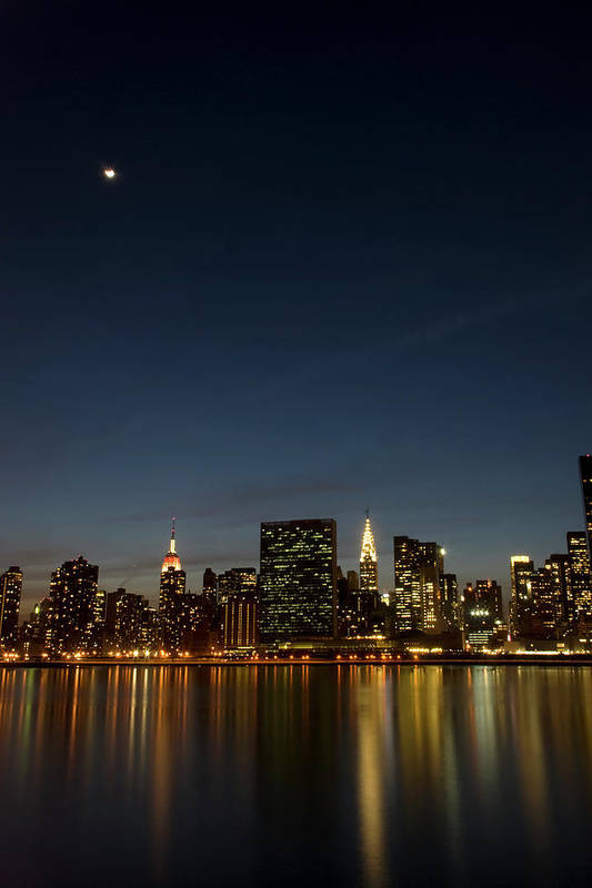 Vertical Art Print featuring the photograph Moon Over Manhattan by Photographs by Vitaliy Piltser
