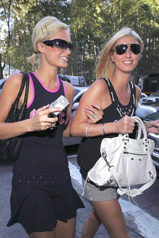 2006 Olympus Spring/summer Fash Art Print featuring the photograph Paris Hilton, Nikki Hilton Carrying by Everett