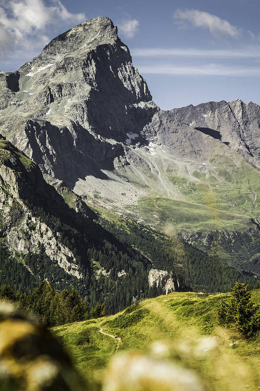 Vertical Art Print featuring the photograph Rocky Mountains Over Grassy Landscape by Manuel Sulzer