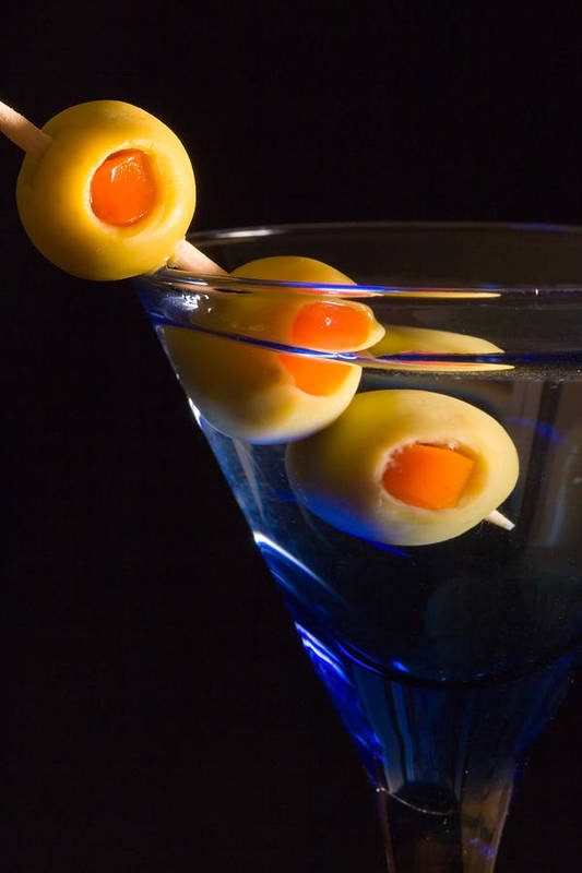 Drink Art Print featuring the photograph Martini Cocktail With Olives In A Blue Glass by ELITE IMAGE photography By Chad McDermott