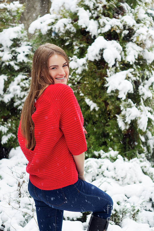 Snow Art Print featuring the photograph Beautiful Young Girl Model In Winter In A Parked Park. In A Red Sweater. by Oleksandr Masnyi
