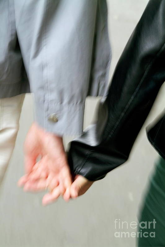 Adult Art Print featuring the photograph Couple Holding Hands While Strolling Down The Street by Sami Sarkis