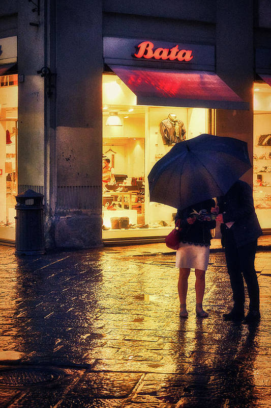 Man and woman under the rain in Florence
