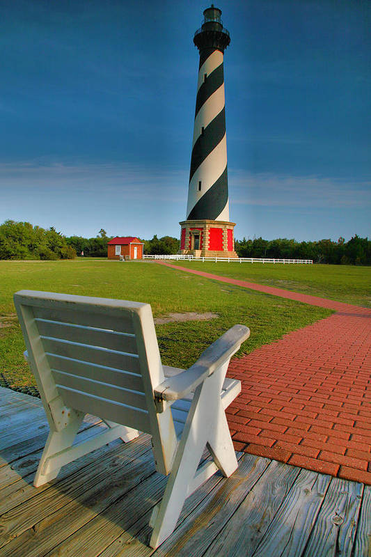 Outer Banks Art Print featuring the photograph Lighthouse And Chair by Steven Ainsworth