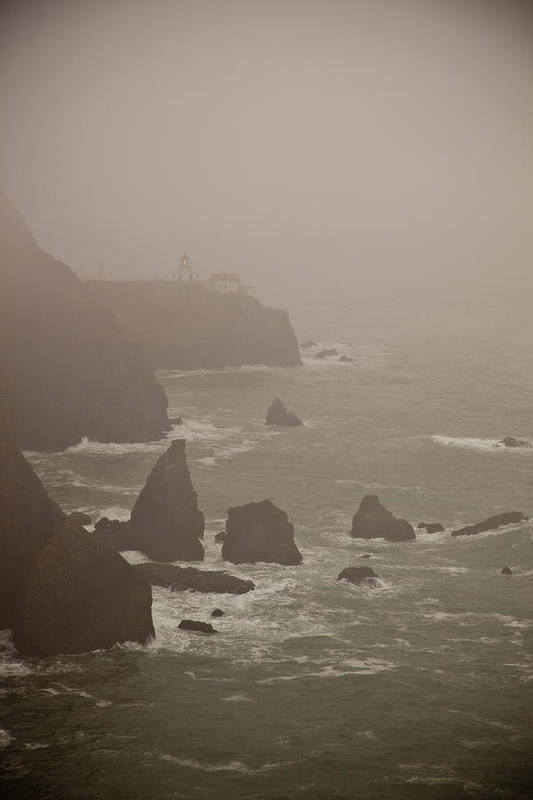 Lighthouse Art Print featuring the photograph Lighthouse In The Fog by Patrick Flynn
