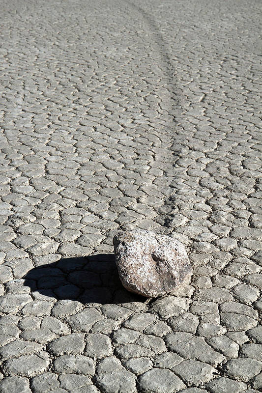 Death Valley Art Print featuring the photograph Moving Stones At The Racetrack Of Death Valley by Pierre Leclerc Photography
