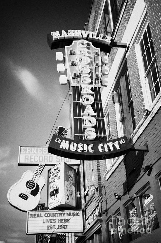 Broadway Art Print featuring the photograph nashville crossroads music city ernest tubbs record shop on broadway downtown Nashville Tennessee US by Joe Fox