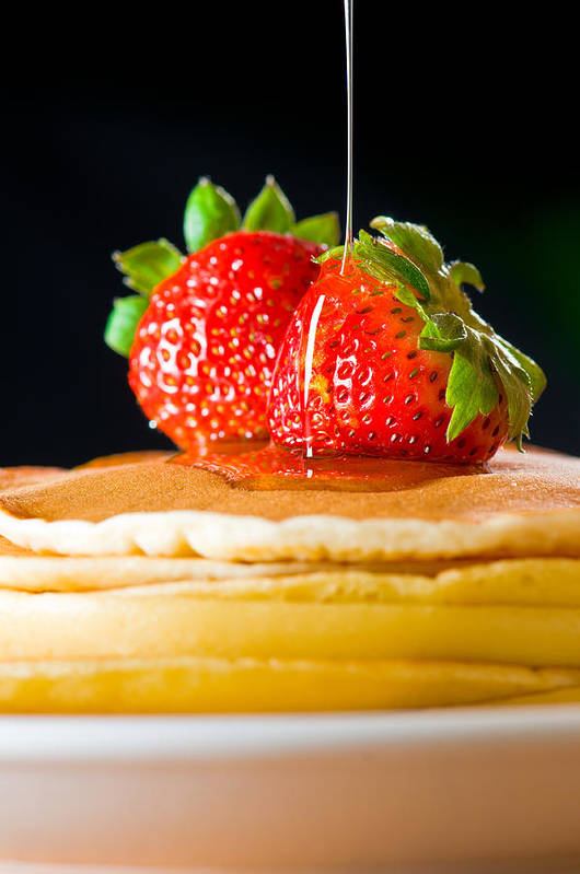 Berries Art Print featuring the photograph Strawberry Butter Pancake With Honey Maple Sirup Flowing Down by Ulrich Schade
