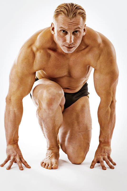 Mature Adult Art Print featuring the photograph Body Builder Posing On White Background by Anouchka