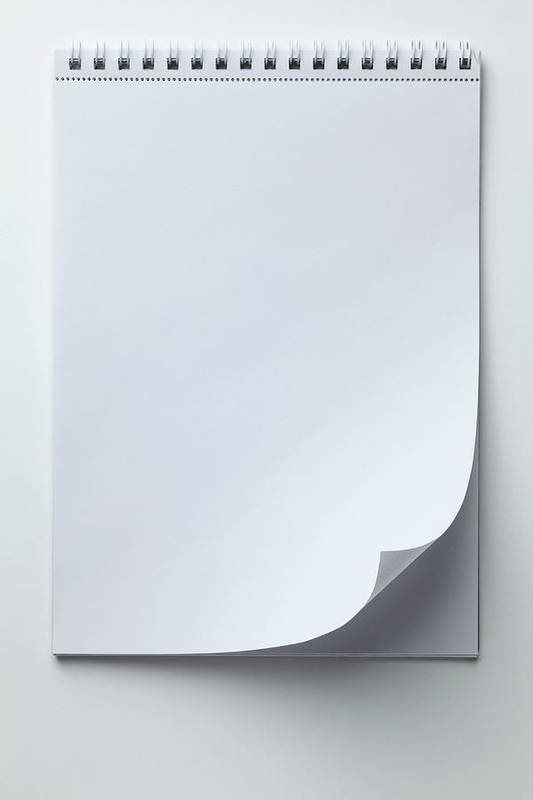 Shadow Art Print featuring the photograph A Blank Sketch Pad With Curled Up Page by Caspar Benson