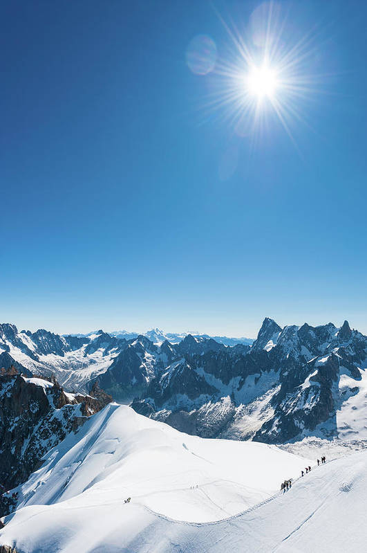 Scenics Art Print featuring the photograph Alps Snow Summit Sunburst Mountaineers by Fotovoyager