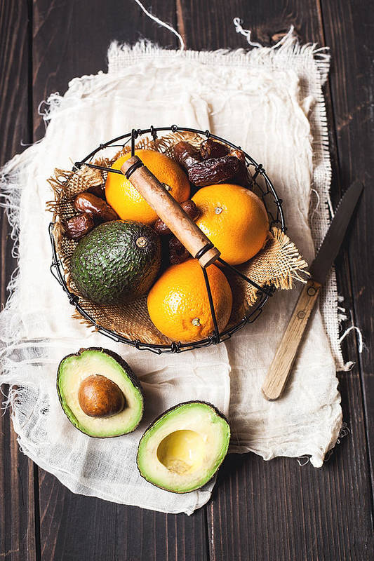 San Francisco Art Print featuring the photograph Basket With Avocado, Oranges And Dates by One Girl In The Kitchen