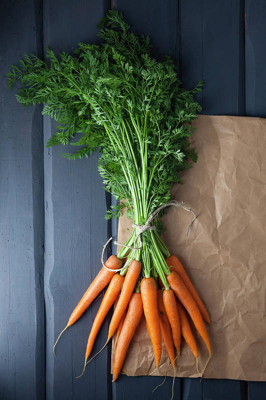 Bunch Art Print featuring the photograph Carrots With Brown Paper On Wooden by Westend61