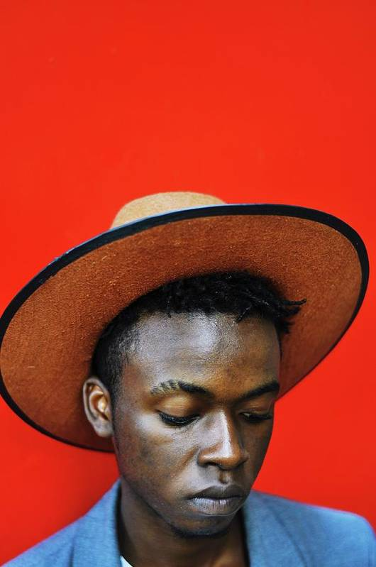 Young Men Art Print featuring the photograph Close-up Of Man Wearing Hat Against Red by Samson Wamalwa / Eyeem