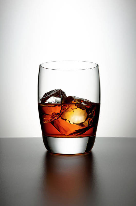 White Background Art Print featuring the photograph Glass With Brown Liquor And Ice Cubes by Chris Stein