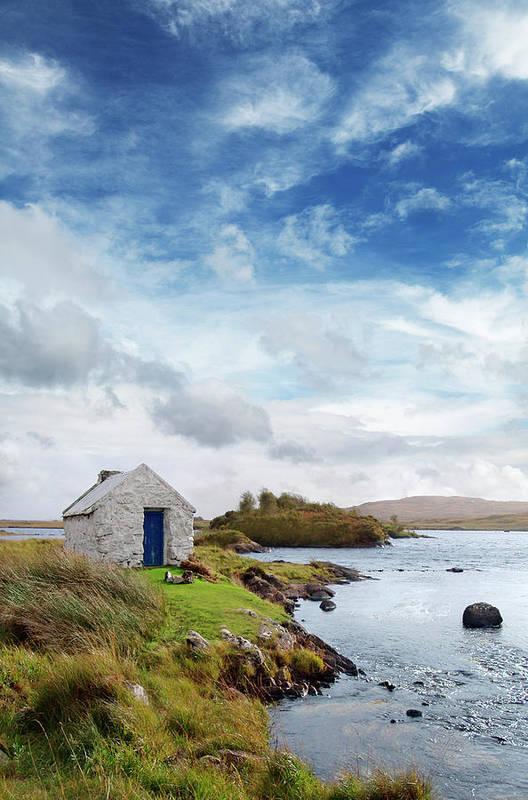 Water's Edge Art Print featuring the photograph Irish Landscape In Connemara by Narvikk