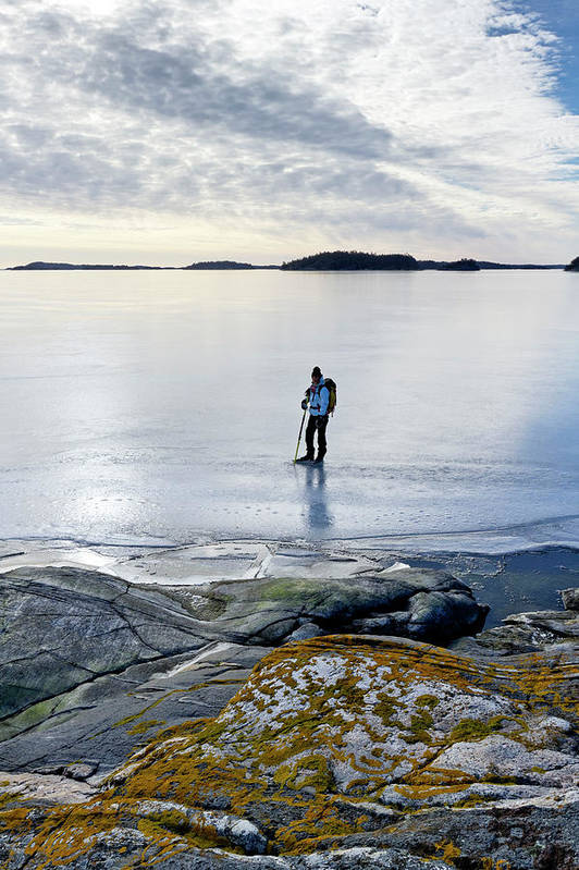 Archipelago Art Print featuring the photograph Person Skating At Frozen Sea by Johner Images