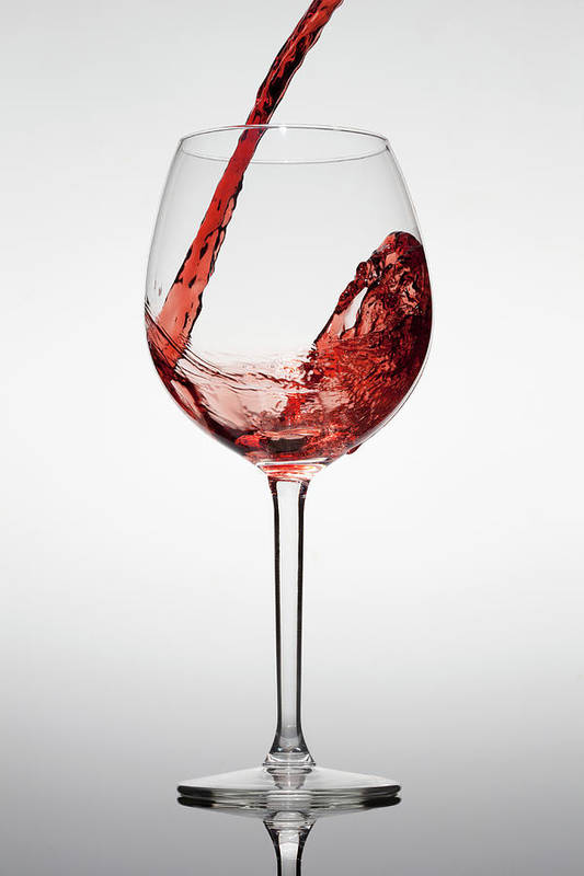 Alcohol Art Print featuring the photograph Red Wine Being Poured Into A Glass by Dual Dual