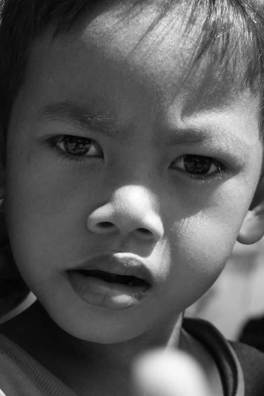 B&w black & White Child Cambodian Curious Art Print featuring the photograph Curious Cambodian child by Linda Russell