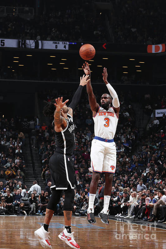 Tim Hardaway Jr. Art Print featuring the photograph New York Knicks V Brooklyn Nets by Nathaniel S. Butler