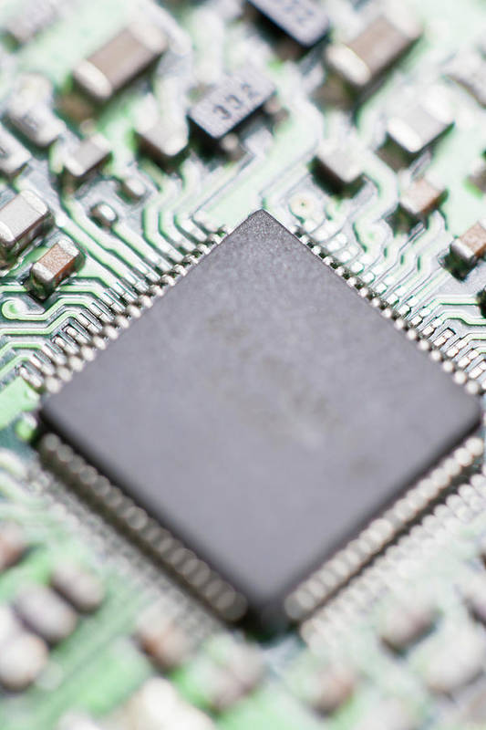 Electrical Component Art Print featuring the photograph Close-up Of A Circuit Board by Nicholas Rigg