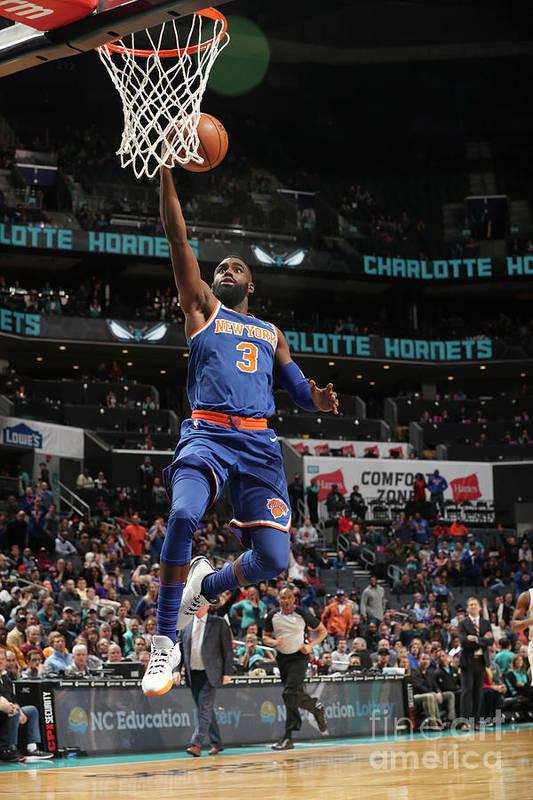 Tim Hardaway Jr. Art Print featuring the photograph New York Knicks V Charlotte Hornets by Kent Smith