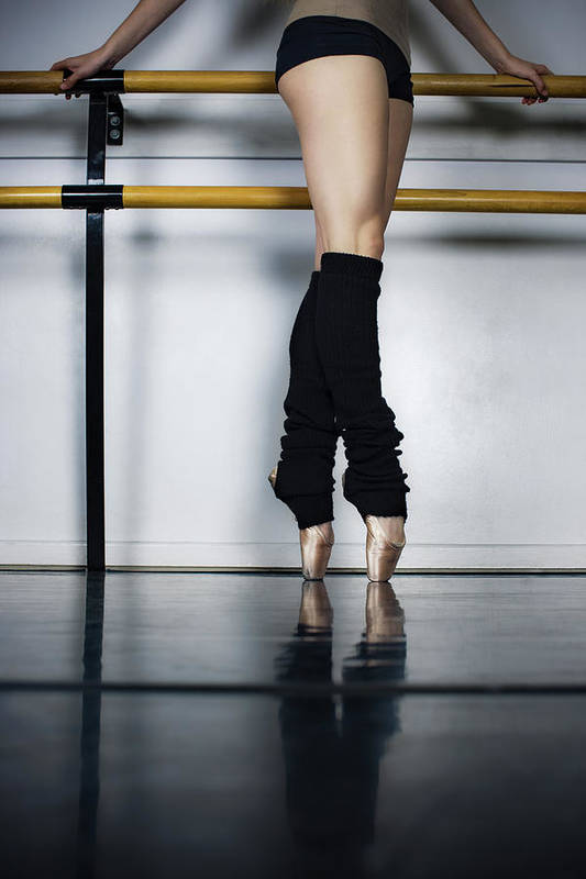 Ballet Dancer Art Print featuring the photograph Ballet Holdiing Bar In Classic Pointe by Patrik Giardino