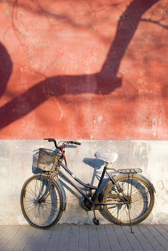 Chinese Culture Art Print featuring the photograph Bicycle Against Red Wall by Frankvandenbergh