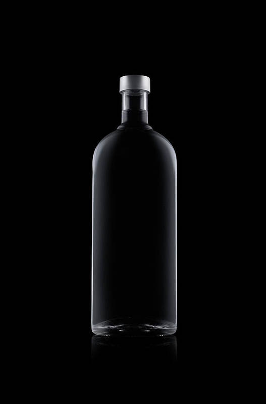Black Color Art Print featuring the photograph Bottle Of Water Isolated On Black by Kedsanee