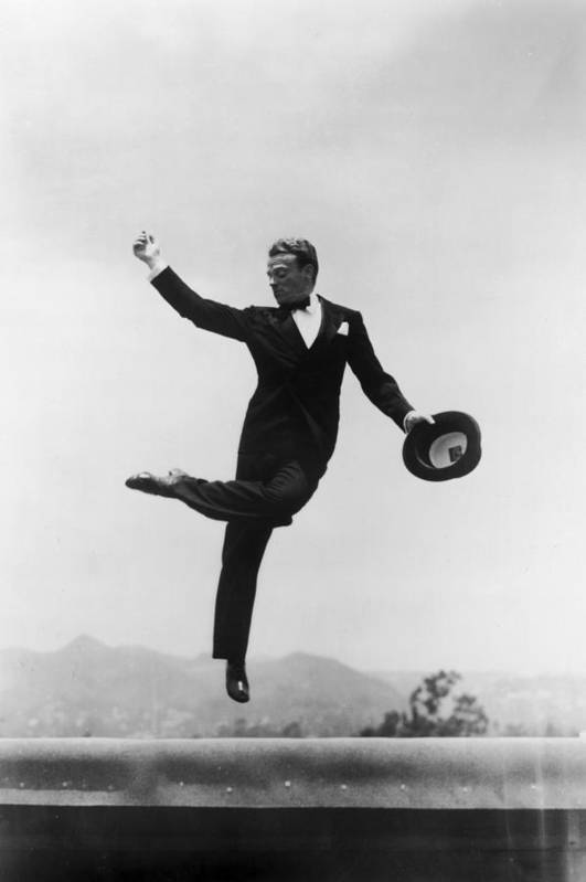 Wind Art Print featuring the photograph Cagney Leaping In Formal Attire by Getty Images