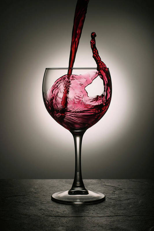 Alcohol Art Print featuring the photograph Dramatic Red Wine Splash Into Wine Glass by Donald gruener
