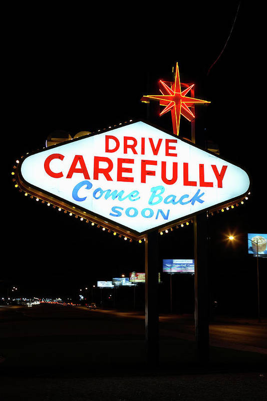 Downtown District Art Print featuring the photograph Drive Carefully, Come Back Soon Sign by Jupiterimages