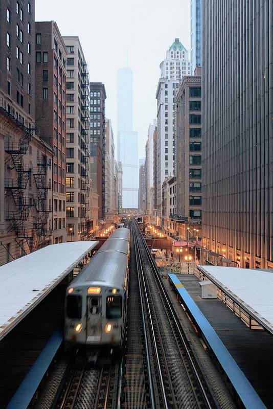 Downtown District Art Print featuring the photograph Elevated Commuter Train In Chicago Loop by Photo By John Crouch