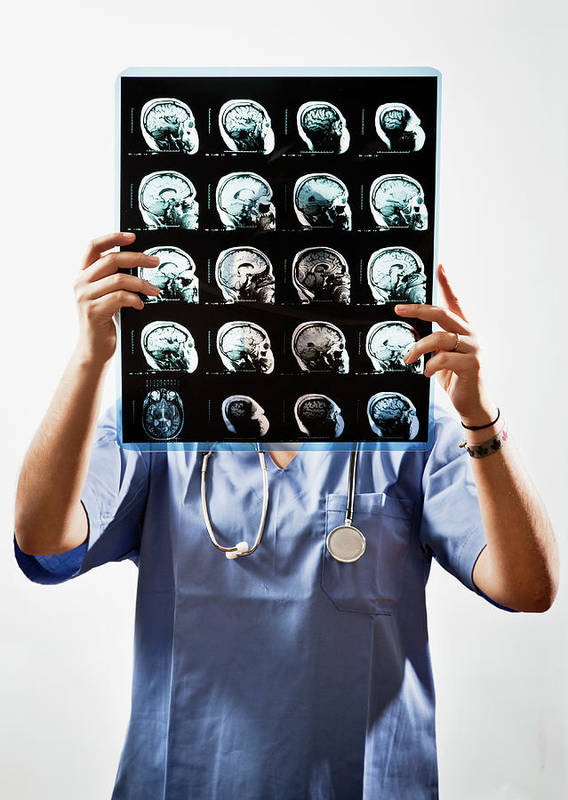 Expertise Art Print featuring the photograph Female Doctor Holds Up Mri In Front Of by Ron Levine