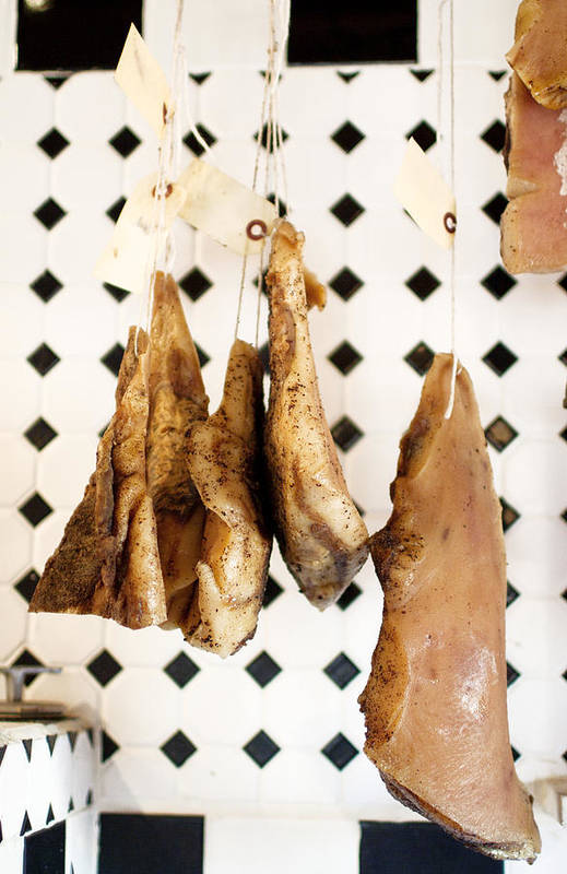 Hanging Art Print featuring the photograph Hanging Cured Pig At La Boucherie by Charity Burggraaf