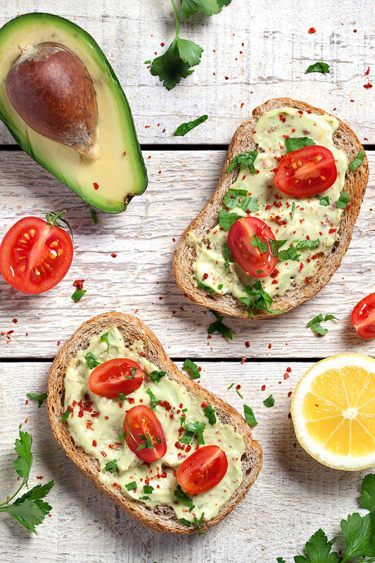 Breakfast Art Print featuring the photograph Healthy Whole Grain Bread With Avocado by Barcin
