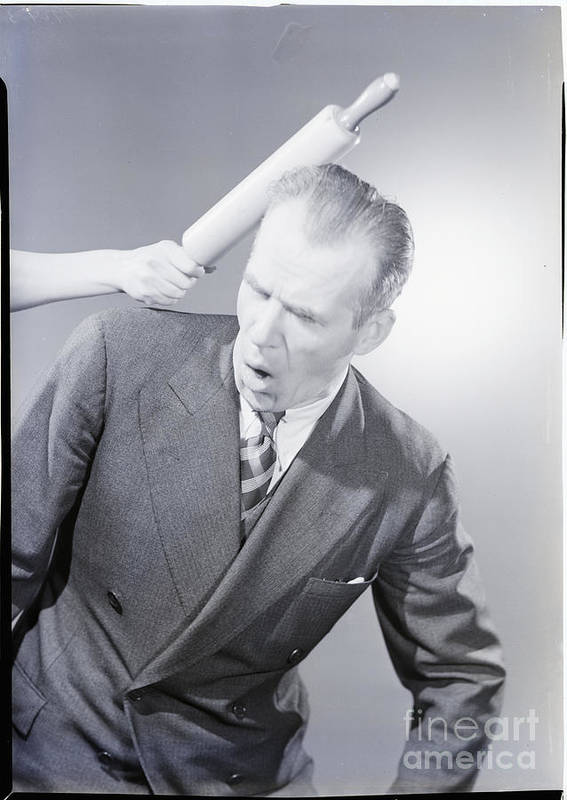 People Art Print featuring the photograph Husband Being Hit With Rolling Pin by Bettmann