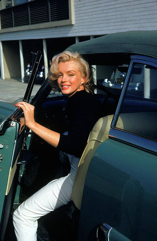 Marilyn Monroe Art Print featuring the photograph Marilyn Monroe Getting Out Of A Car by Alfred Eisenstaedt
