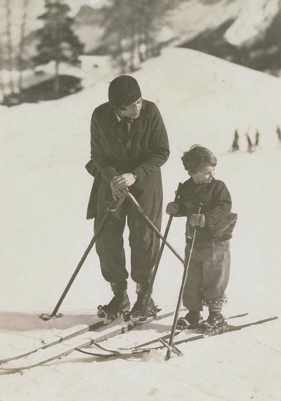 Skiing Art Print featuring the photograph Mother And Son Skiing by Kurt Hutton