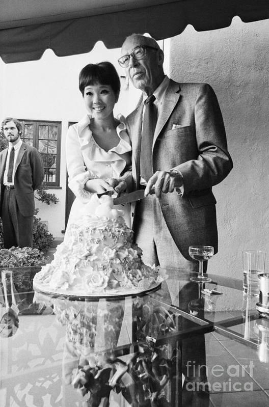 People Art Print featuring the photograph Newlyweds Cutting Wedding Cake by Bettmann