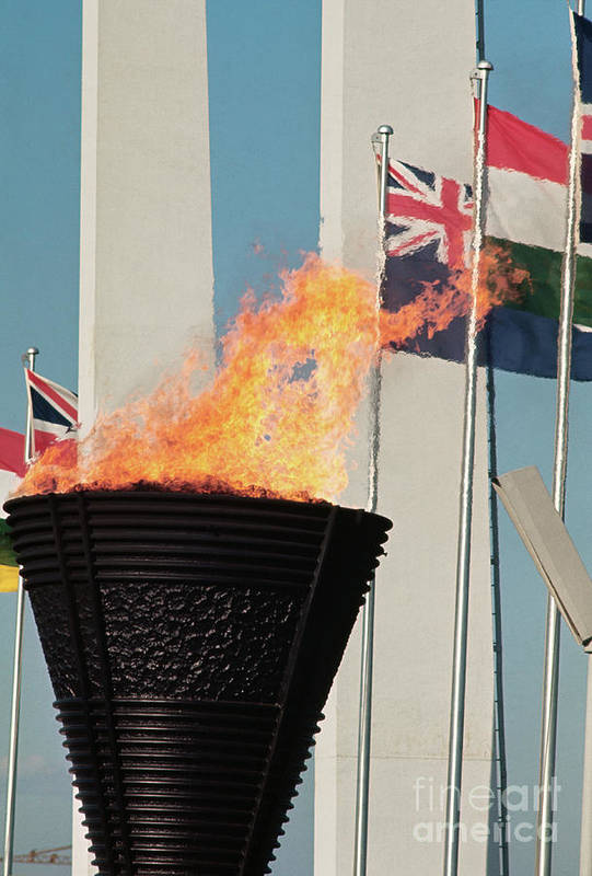 The Olympic Games Art Print featuring the photograph Olympic Torch by Bettmann