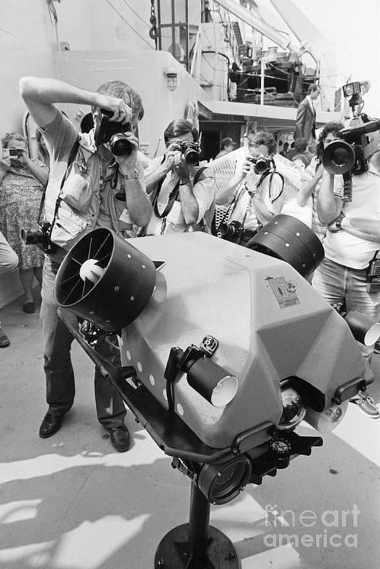 1980-1989 Art Print featuring the photograph Photographers Gathered Around Robotic by Bettmann