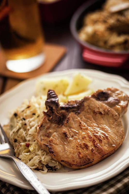 Meat Chop Art Print featuring the photograph Pork Chop And Sauerkraut by Gmvozd
