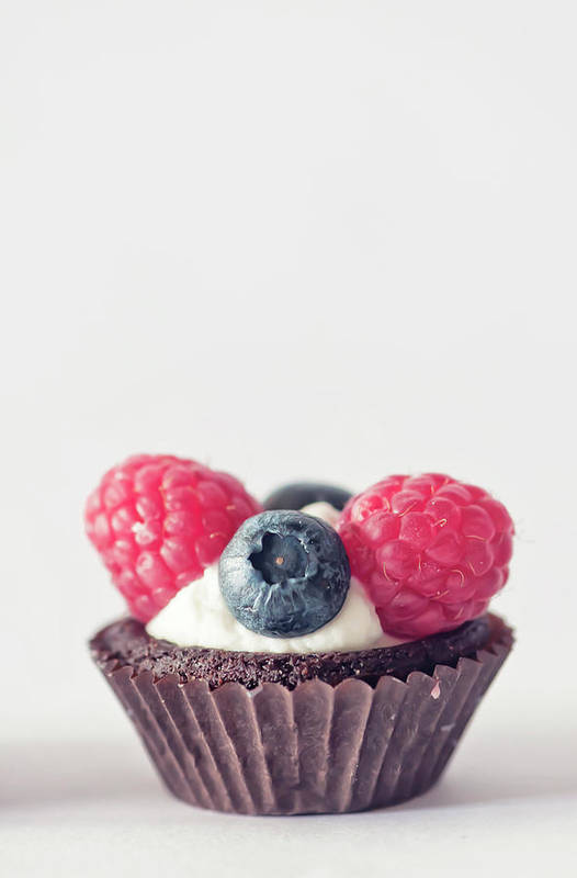 Unhealthy Eating Art Print featuring the photograph Raspberries And Blueberries Cupcake by Marta Nardini