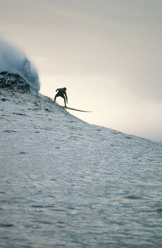 Scenics Art Print featuring the photograph Silhouette Of A Surfer Riding A Wave by Dominic Barnardt